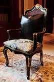 Corner chair. Beautiful and decorative chair sitting on carpet and/or tile floor Stock Image