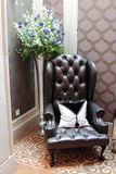 Corner chair. Beautiful and decorative chair sitting on carpet and/or tile floor Royalty Free Stock Image