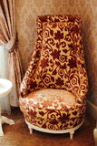 Corner chair. Beautiful and decorative chair sitting on carpet and/or tile floor Royalty Free Stock Photo