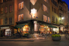 Corner coffee-shop in Geneva, Switzerland. Place de Bourg is the heart of the old town in Geneva, Switzerland. The numerous terraces offering drinks and food are Stock Photo