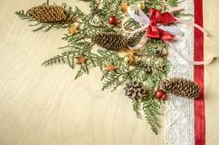 Corner collected from twigs of thuja with fir cones Royalty Free Stock Photography