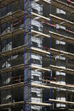 Corner of concrete building under construction with scaffolding. In Moscow, Russia royalty free stock images