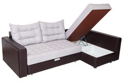 Corner convertible sofa bed with storage system, upholstery whit Stock Photo