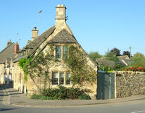 Corner cottage. Delightful stone build cottage in the cotswolds Stock Images