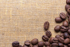 Corner decoration of coffee beans on sacking material Stock Photos