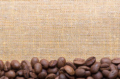 Corner decoration of coffee beans on sacking material Royalty Free Stock Image