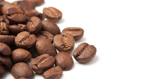 Corner decoration of coffee beans on white background Royalty Free Stock Photos
