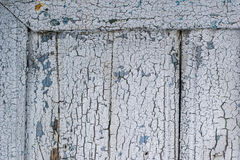 Corner detail of old door with grunge surface paint texture Royalty Free Stock Photo