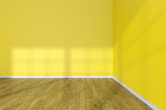 Corner of empty room with yellow walls and wooden parquet floor. Corner of empty room with hardwood parquet floor, yellow walls and sunlight from window on the Royalty Free Stock Images