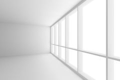 Corner of empty white business office room with large window. Business architecture white colorless office room interior - corner of empty white business office Royalty Free Stock Image