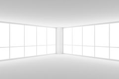 Corner of empty white business office room with two large window. Business architecture white colorless office room interior - corner of empty white business Royalty Free Stock Photo