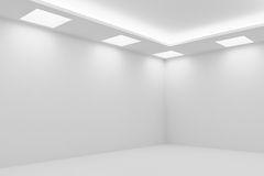 Corner of empty white room with square ceiling lights. Abstract architecture white room interior - corner of empty white room with white wall, white floor, white Stock Images