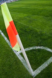 Corner flag. Red yellow flag - corner of the soccer field Stock Photography