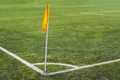 Corner flag on the football field. Yellow corner flag on the football field Stock Images