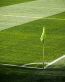 Corner flag on football (soccer) pitch. Detail from the corner and flag of a football (soccer) pitch Stock Images