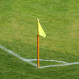 Corner flag on a soccer field. Yellow corner flag on a soccer field stock images