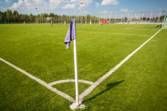 Corner flag on soccer field at sunny day Stock Photo