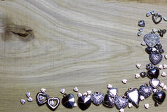 Corner frame border of Hearts beads on wooden background. Royalty Free Stock Photos