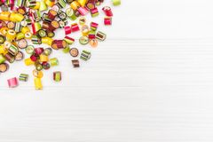 A corner frame made of colored caramel candies Royalty Free Stock Photography