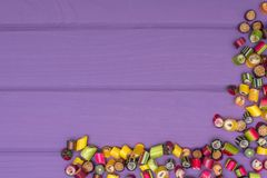 A corner frame made of colored caramel candies Royalty Free Stock Image