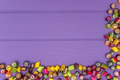 A corner frame made of colored caramel candies Stock Photo
