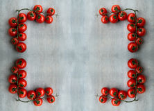 Corner of fresh red delicious tomatoes  on an  old wooden tablet Stock Images