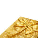 Corner of a  gift in golden wrapping with clipping path Stock Photography