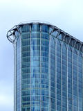 Corner glass building. Corner of tall office building with sky in background royalty free stock photo