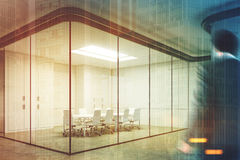 Corner of a glass meeting room, man Royalty Free Stock Image