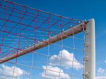 Corner Goal. Photo corner of the old gates of football in the sky and clouds Royalty Free Stock Image