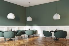 Corner of a green and white bar interior. Corner of a green and white cafe interior with a wooden floor, round black tables and green chairs. A poster. 3d Royalty Free Stock Images