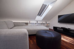 Corner grey sofa in attic Royalty Free Stock Photography