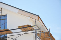 Corner of house with eaves, rafters, truss. Install softies and roof insulation detail. Roofing. Stock Photos