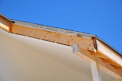 Corner of house with eaves, wooden beams. Install soffits Stock Images