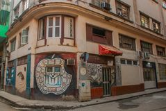 Corner house with graffiti, drawing on the wall, unusual Apple in downtown Havana. Cuba royalty free stock photo