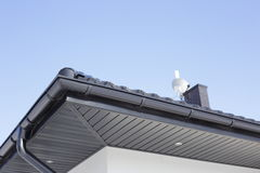 Corner of the house with gutter. Stock Image