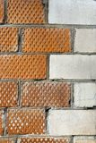 The corner of the house is made of bricks with a decorative corner element Royalty Free Stock Photography