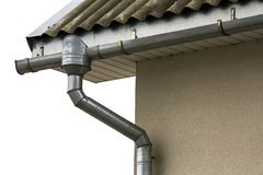 Corner of a house with a steel gutter system royalty free stock photography