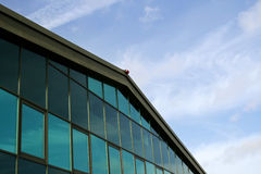 Corner of industrial building. With blue cloudy sky background royalty free stock photo