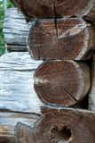 Corner interlocking logs. Corner of a log cabin home with cut and hewn logs stacked horizontally and interlocking the structure n Stock Images