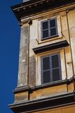 Corner of an Italian building with yellow plaster royalty free stock images