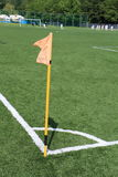 Corner kick. Football field with artificial grass, players, corner kick and flag Stock Photos
