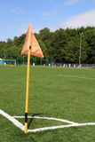 Corner kick. Football field with artificial grass, players, corner kick and flag Royalty Free Stock Image
