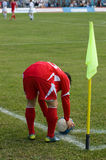 Corner kick. The football player in the red form carries out corner kick Stock Photos