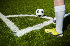 Corner kick. Football player going to take a corner Royalty Free Stock Image