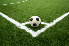 Corner kick on green grass Stock Image