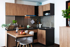 Corner kitchen with dining table in room condominium. stock photos
