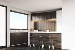 Corner of kitchen with stools and bar Royalty Free Stock Images