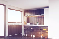 Corner of kitchen with stools and bar, toned Stock Image