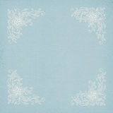 Corner lace frame on blue paper Royalty Free Stock Images